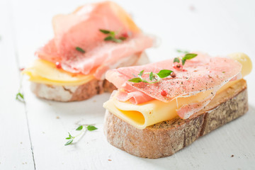 Crisp sandwich with ham and cheese for breakfast