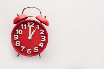 Red alarm clock isolated on white background. Business time.