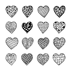 Set of beautiful black and white hand drawn monochrome hearts isolated.