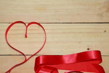 Design Red heart shaped ribbon awareness on old aged wood backgr