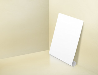 Blank white rolling poster at corner painted pastel yellow color