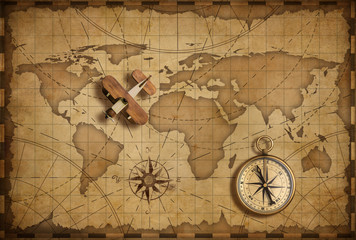 Wall Mural - Small wood airplane over world nautical map as travel and communication concept