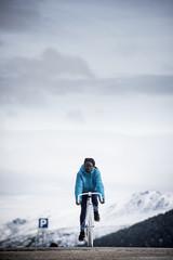 Woman cycling on white bike