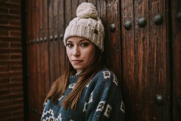 Woman posing at wooden door