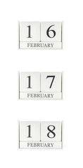 Closeup group of white wooden calendar with black 16 , 17 , 18 february word , three date calendar isolated on white background