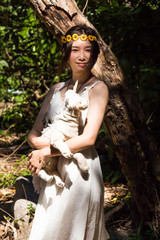 Portrait a beautiful girl,in nature forest light,fashion style of young pretty beautiful woman and horse doll in happy and smile