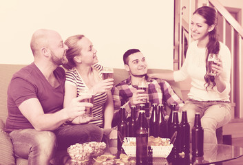Two couples having fun at house party