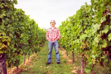 Winemaker Standing By His Vineyard