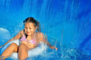 Real toddler girl relaxing at swimming pool