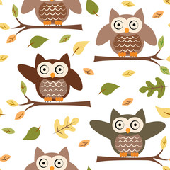 Seamless pattern with owls on the tree branch and fall foliage on a white background
