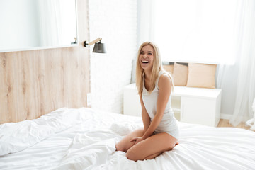 Laughing woman on bed