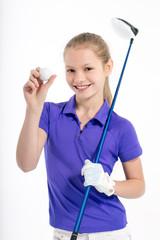 Pretty girl golfer posing with golf club on white backgroud in studio