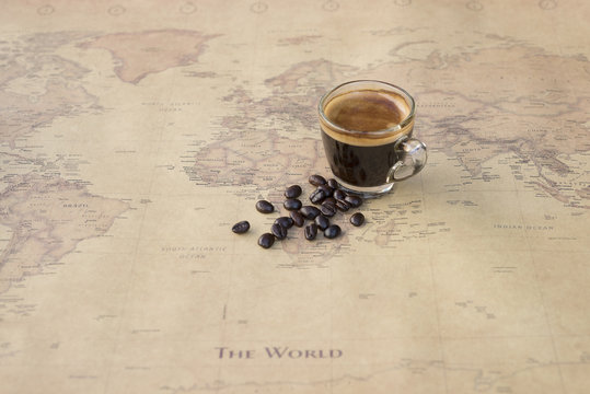 Black coffee  with bean on world map background