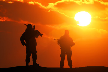 Two silhouette of a soldier on a beautiful background
