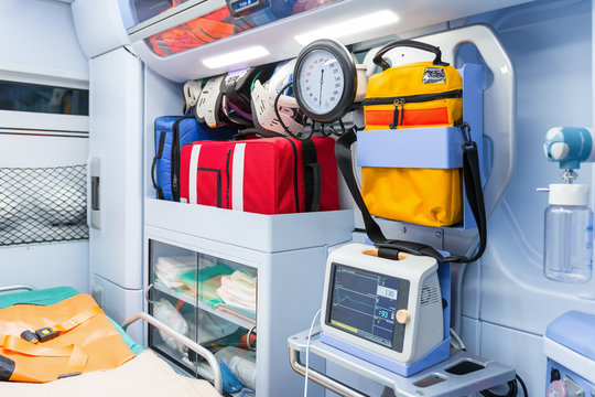Inside the ambulance, view from the sanitary compartment. Different medical equipment and a baralla. Selective focus, high key.