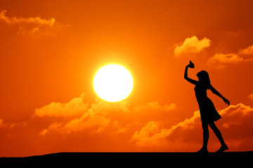 silhouette girl dancing on the background of a beautiful sunset