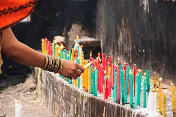Candles of offering in Buddhist temple.
