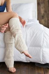 Girl dresses knee socks.