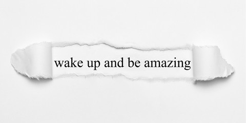 wake up and be amazing on white torn paper