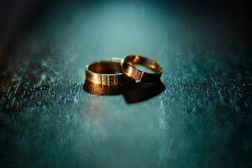 Wedding rings with water droplets against