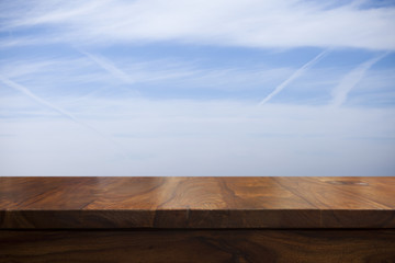 Empty top wooden table and sky