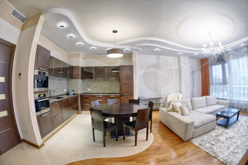 Russia, Moscow region - interior design kitchen - living room in luxury new apartment