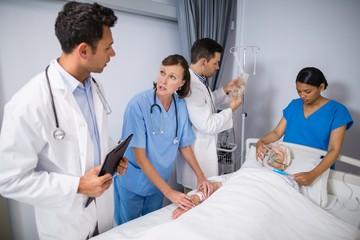 Doctors examining senior patient