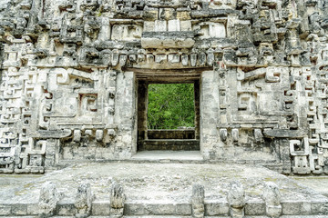 sight of the front of the house of the mouth of the snake in the archaeological place of Chicanna, in the reservation of the biosphere of Calakmul, Campeche, Mexico.
