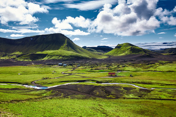 Travel to Iceland. The charming rustic rural house in the national park in Iceland, on beautiful landscape background