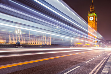 Big Ben in Westminster London at night with car traffic light trails