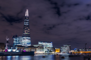 London skyline at night with shard tower skyscraper building
