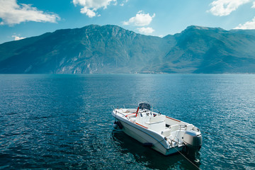 Motor boat on beautiful Garda lake, Italy