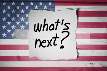 What's Next? on torn paper and the American flag