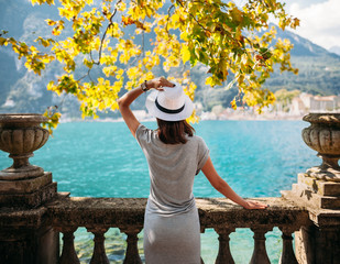 Young woman relaxing on beautiful Garda lake