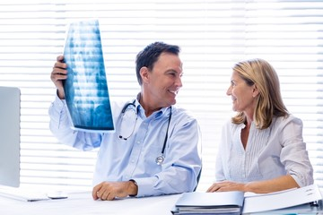 Doctor discussing x-ray report with patient