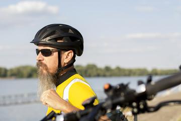 Male cyclist resting