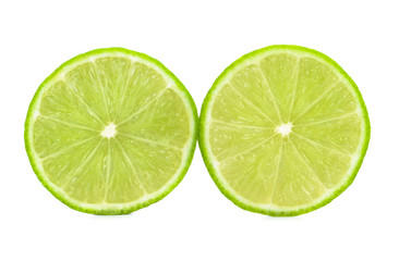 Ripe lime cut in half isolated over the white background