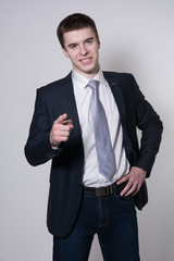 Portrait of a smiling young businessman pointing his finger