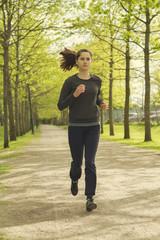 In de dag Ontspanning Runner in action. Jogging woman running in park on beautiful