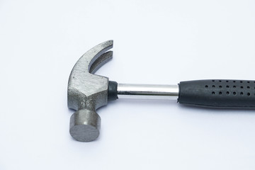 Stainless steel hammer with black handle on isolated white background