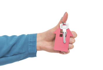Key from the house in a female hand.