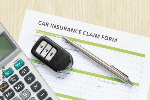 Top View Of Car Insurance Claim Form With Car Key And