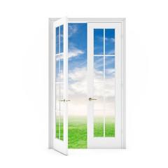 open door to the grass field with sky