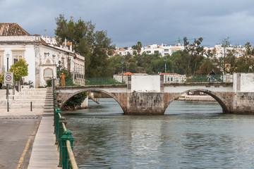 Old roman bridge in Tavira. Algarve region, Portugal.
