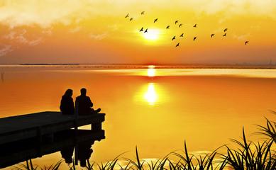 Wall Mural - escena romantica de unos novios mirando la puesta de sol