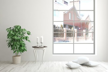 White interior design with flower and winter landscape in window