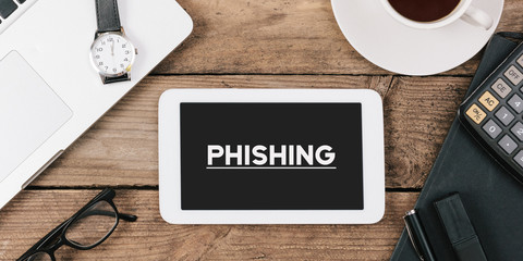 phishing on phone on Office desk with computer technology, high