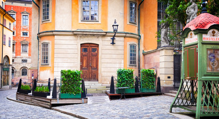 Stockholm Sweden beautiful street old buildings and antique public phone booth. Scandinavian style