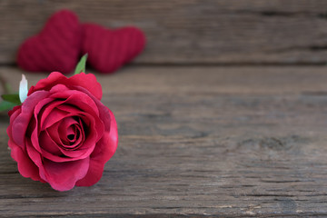 Red rose flower closeup on rustic wooden table