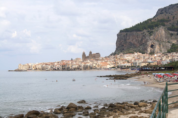 View of the town, beach and mountain of the ancient town of Cefalu, Sicily, Italy